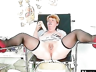 Filthy mature lady toys her hairy pussy with..